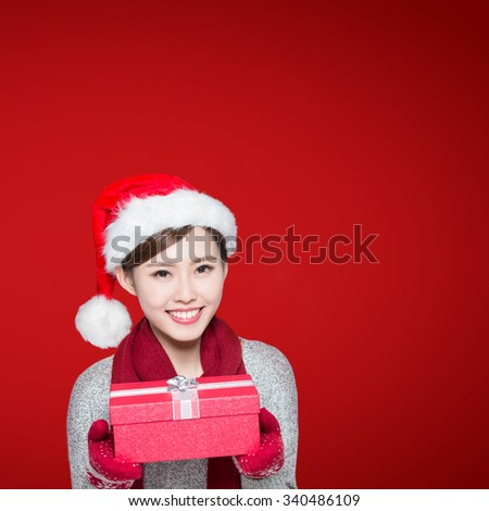 Happy woman is delivering Christmas gifts, asian - stock photo