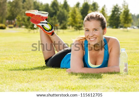 Happy woman jogger training in the park. Healthy lifestyle and physical exercise feels good. - stock photo