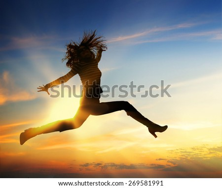 Happy woman jumping - stock photo