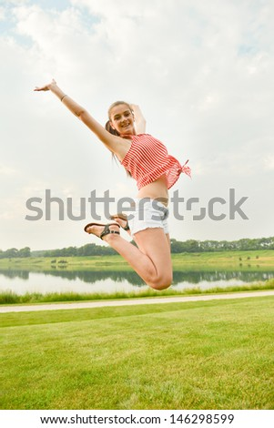 Happy woman jumping expressing winning, success, excitement, and fun lifestyle