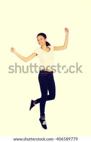 Happy woman jumping with hands up. - stock photo