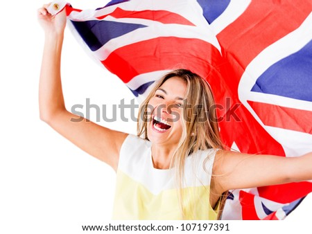Happy woman laughing and holding the British flag - isolated over white - stock photo