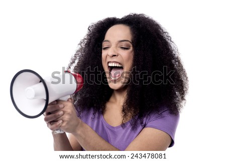Happy woman laughing loudly over bull horn - stock photo