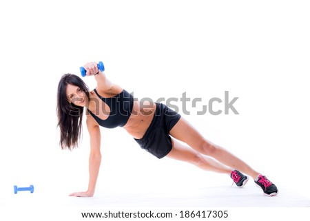 Happy woman lifting pairs of small dumbbells