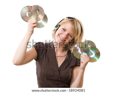 happy woman listening music with cds in the hands - stock photo