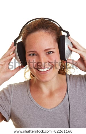Happy woman listening to music with headphones - stock photo