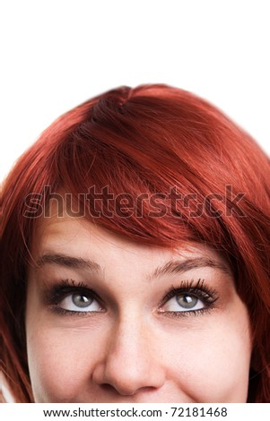 Happy woman looking up and above over white - stock photo