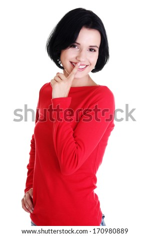 Happy woman making a keep it quiet gesture , isolated on white  - stock photo
