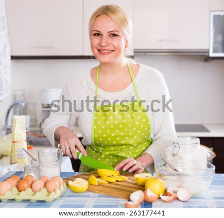 Happy woman making tasty apple pie at home - stock photo