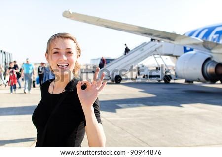 happy woman near airship happy of good landing - stock photo