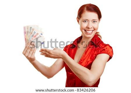 Happy woman offering fan of Euro money bills - stock photo