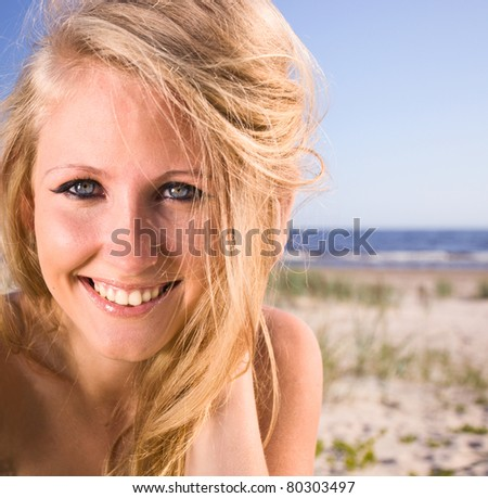 happy woman on a beach. - stock photo