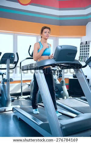 Happy woman on a treadmill.