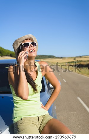 Happy woman on cellphone call enjoying summer car travel vacation. Female traveler  on roadtrip in Spain. - stock photo
