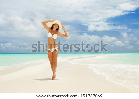 Happy woman on the beach - stock photo