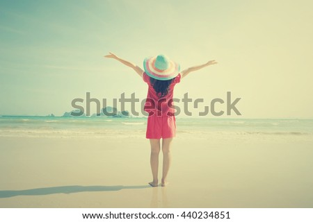 Happy woman on the beach,Summer vacation concept.Vintage tone. - stock photo
