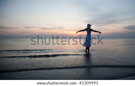 Happy woman on the beachfront. Travel collection.