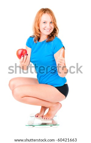 Happy woman on weight scale - stock photo