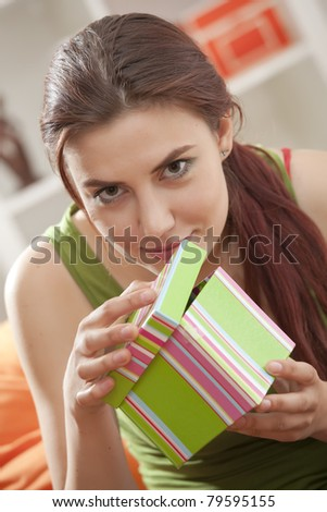 happy woman opening gift box at home - stock photo