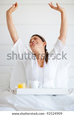 Happy woman ordering room service for breakfast - stock photo