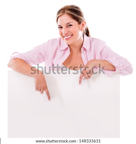 Happy woman pointing a banner ad - isolated over white  - stock photo