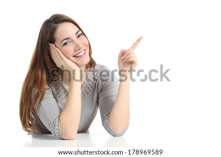 Happy woman pointing and presenting at side looking at camera isolated on a white background               - stock photo