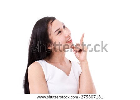 happy woman pointing up at blank space - stock photo