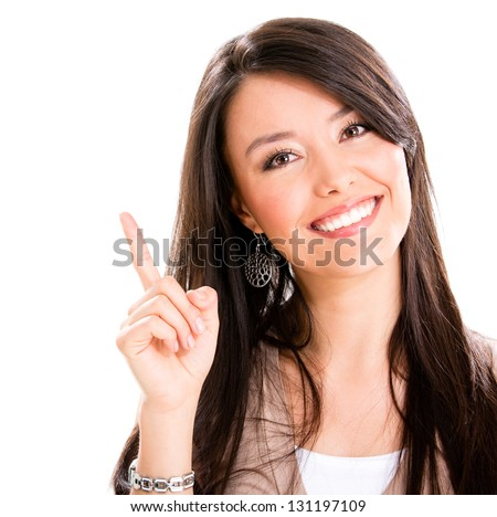Happy woman pointing up with her finger - isolated over white - stock photo
