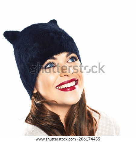 Happy woman portrait. Hat with ears. Isolated. Young smiling model.