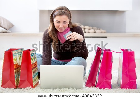 happy woman portrait shopping online with bags at home - stock photo