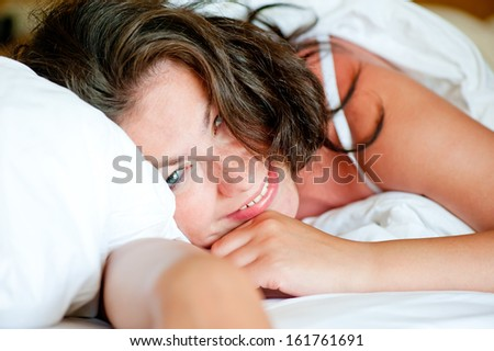 Happy woman quietly sipped at home in bed after waking up - stock photo