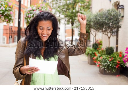 happy woman reading a letter - stock photo