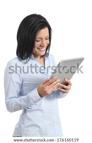 Happy woman reading a tablet reader isolated on a white background - stock photo
