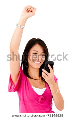 Happy woman reading a text message on her cell phone - isolated over white - stock photo