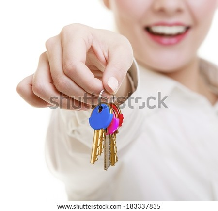 Happy woman real estate agent holding set of keys to new house or car. Property business and accommodation or home buying ownership concept, isolated on white background - stock photo