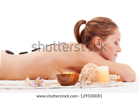 happy woman receiving spa stones therapy