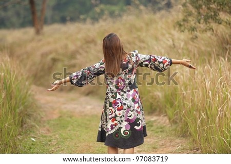 happy woman relaxing in nature - stock photo