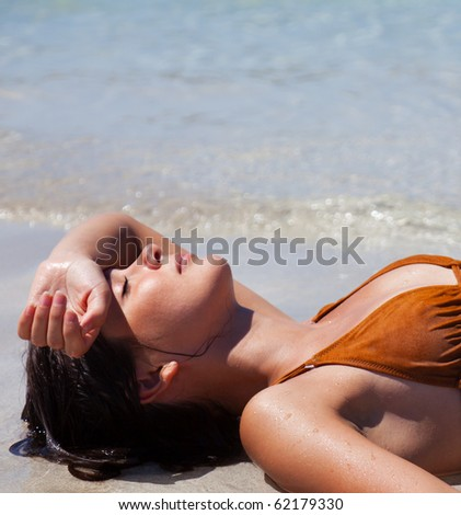 Happy woman relaxing in the water in a sea - stock photo
