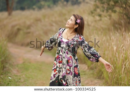 happy woman relaxing in wild tropical nature, thailand - stock photo