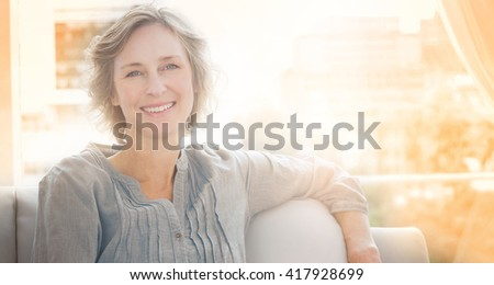 Happy woman relaxing on her couch at home in the sitting room