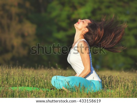 Happy woman relaxing outdoor. Hair flying. - stock photo