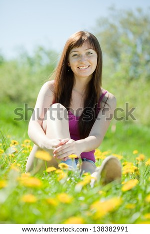 Happy   woman  relaxing outdoor in grass - stock photo
