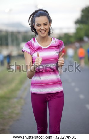 happy woman running and jogging path