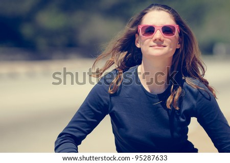 Happy Woman running in pink sunglasses - stock photo