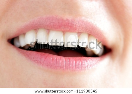 Happy woman's mouth - stock photo