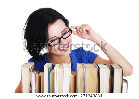 Happy woman searching for an interesting book. - stock photo