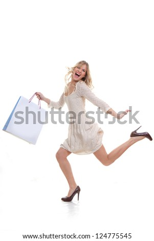 happy woman shopper hurrying for shopping sales concept - stock photo
