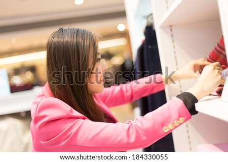 Happy woman shopping and holding bags girl