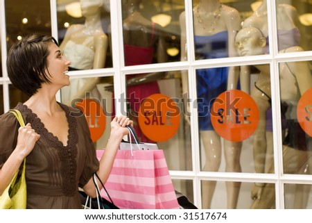Happy woman shopping at an outdoor mall - stock photo