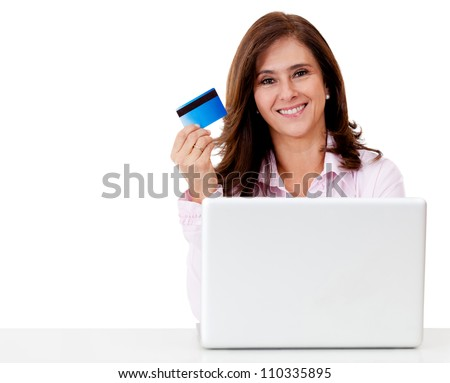 Happy woman shopping online paying with credit card - isolated over a white background - stock photo